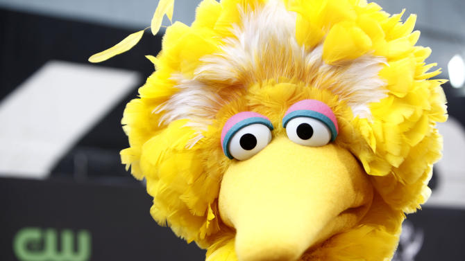 FILE - This Aug. 30, 2009 file photo shows Big Bird, of the children's television show Sesame Street, in Los Angeles. Halloweencostumes.com sold out of several takes on Big Bird almost overnight after Romney's remark during the first presidential debate Oct. 3. Disguise Inc., Sesame Workshop's official costume maker, said interest is up among the thousands of retailers it services. The sellers of unlicensed Big Bird, especially sexed-up versions, beware.   (AP Photo/Matt Sayles, File)
