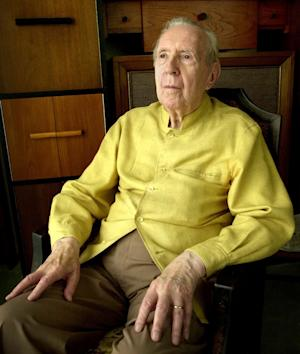 """In this Sept. 17, 2002 file photo, Jacques Barzun sits for a portrait at his home in San Antonio.  Barzun, the pioneering cultural historian who became a best-selling author in his 90s with """"From Dawn to Decadence,"""" has died. He was 104. Barzun's son-in-law says Barzun passed away Thursday, Oct. 25, 2012,  in San Antonio, where he'd lived in recent years. Barzun wrote dozens of books and essays on everything from philosophy and music to detective novels. (AP Photo/Eric Gay)"""