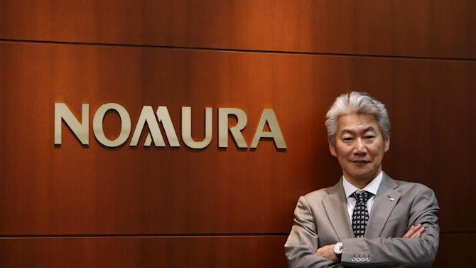 Nomura Holdings' Chief Executive Officer Nagai poses for pictures after an interview with Reuters in Tokyo
