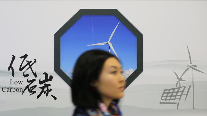 A woman walks in front of the chinese showcase during the World Climate Change Conference 2015 (COP21) at Le Bourget, near Paris, France