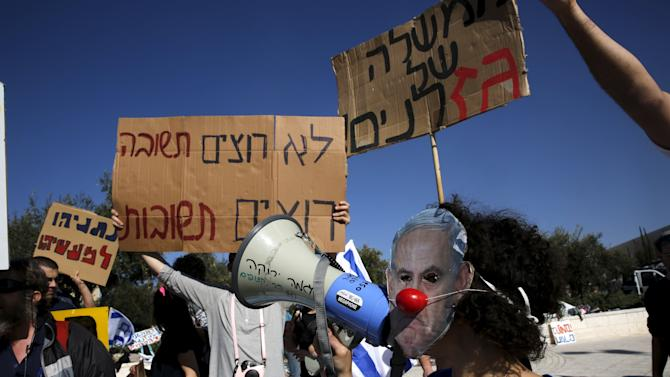 Israelis protest against the gas framework deal outside the Supreme Court in Jerusalem as Prime Minister Benjamin Netanyahu arrives to speak at a court hearing about the legality of the deal