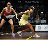 Nicol David of Malaysia (right) competes in the women's final against Laura Massaro of England at the Australian Open squash tournament in Canberra. Top-ranked David beat Massaro 17-15, 11-2, 11-6