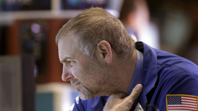 Barclays Specialist Geoffrey Friedman looks at his computer screen at the New York Stock Exchange in New York, Wednesday, Dec. 26, 2012.  (AP Photo/Kathy Willens)
