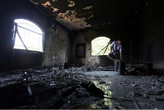 In this Thursday, Sept. 13, 2012 file photo, a Libyan man investigates the inside of the U.S. Consulate after an attack that killed four Americans, including Ambassador Chris Stevens, on the night of