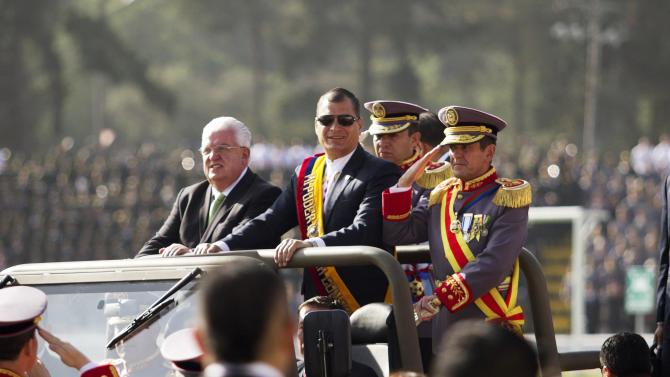 Ecuadorean President Correa looks on from a vehicle next to Defense Minister Cordero as he arrives for a military ceremony at the Eloy Alfaro military school in Quito