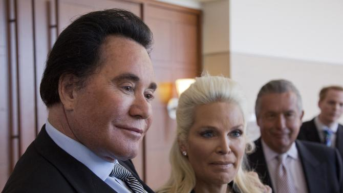 "Wayne Newton, left, and his wife Kathleen McCrone Newton speak to members of the media after a court hearing for a counterclaim on a lawsuit filed against them, Thursday, May 31, 2012, in Las Vegas. The entertainer's lawyers are denying allegations of mismanagement, animal abuse and sexual harassment lodged in a lawsuit by a business associate, and responding with counterclaims alleging breach of contract and fraud. Documents filed Wednesday in Nevada state court label as ""scurrilous and scandalous"" allegations in a lawsuit filed two weeks ago by the company that purchased rights to convert Newton's home into a tourist attraction. (AP Photo/Julie Jacobson)"