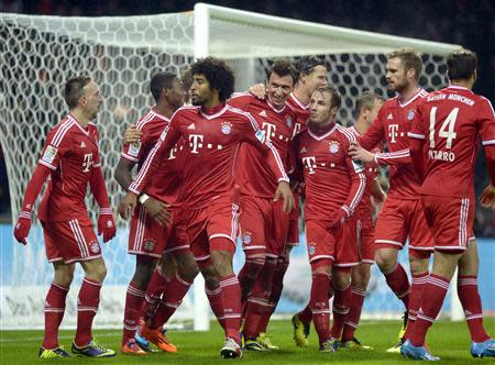 Bayern Munich players celebrate during their German Bundesliga first division soccer match against Werder Bremen in Bremen