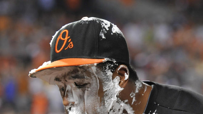 Baltimore Orioles' Chris Dickerson blows off his headset after being hit with a shaving cream pie after hitting a three-run walkoff home run against the Detroit Tigers, Friday, May 31, 2013, in Baltimore. The Orioles won 7-5. (AP Photo/Gail Burton)