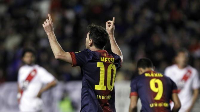 FC Barcelona's Lionel Messi from Argentina, second left, celebrates his goal during a Spanish La Liga soccer match against Rayo Vallecano at the Teresa Rivero stadium in Madrid, Spain, Saturday, Oct. 27, 2012. (AP Photo/Andres Kudacki)