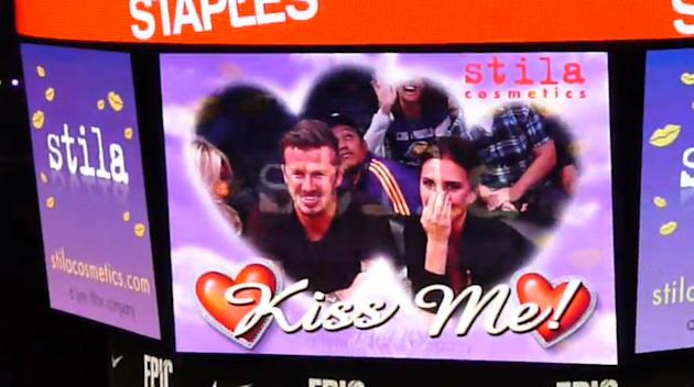 * DAVID AND VICTORIA BECKHAM SMOOCH AT BASKETBALL GAMESoccer superstar DAVID BECKHAM and his wife Victoria delighted spectators at a basketball game in Los Angeles on Tuesday (01May12) when they pucke