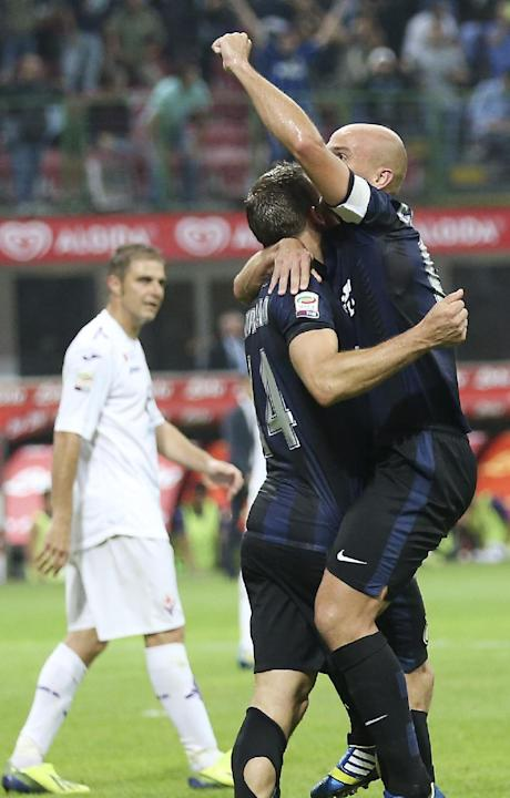 Inter Milan Argentine midfielder Esteban Cambiasso, top right, celebrates with his teammate defender Hugo Campagnaro, of Argentina, after winning the Serie A soccer match between Inter Milan and Fiore