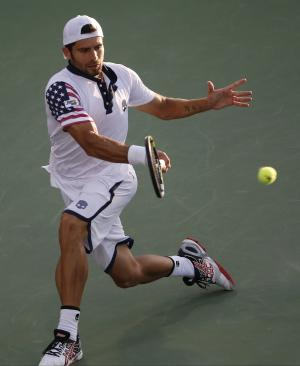 Simone Bolelli, of Italy, returns a shot against Tommy Robredo, of Spain, during the second round of the 2014 U.S. Open tennis tournament, Thursday, Aug. 28, 2014, in New York. (AP Photo/Kathy Willens)
