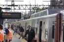 Commuters arrive at the South Norwalk train station to be transferred to buses to Bridgeport to re-board Metro-North trains bound for New Haven