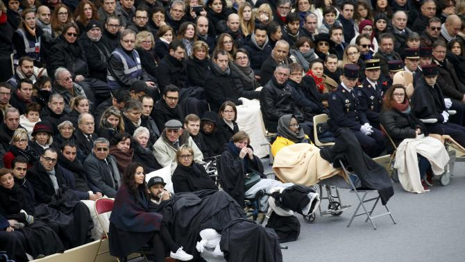 People wounded in the Paris attacks and family members attend a ceremony to pay a national homage to the victims of the Paris attacks at Les Invalides monument in Paris