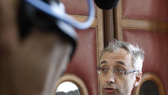 Jean-Paul Guerlain's lawyer Basile Ader addresses reporters at a Paris Court House, in Paris Thursday March 29, 2012, after a French court convicted longtime perfume maker Jean-Paul Guerlain of making racist insults on national television and fined him Thursday Euros 6,000 ($8,000). The 75-year-old Guerlain, an heir to his family's cosmetics empire, provoked anger among French minorities with the comments in a 2010 interview on France-2 television. Lawyers for the SOS Racism association said Guerlain abused the national platform he was given. (AP Photo/Remy de la Mauviniere)