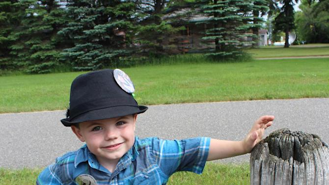 In this photo made Wednesday, June 26, 2013 in Dorset , Minn., Bobby Tufts, the small town's 4-year-old mayor, poses for a photo before starting the Ronald McDonald fundraising walk. Bobby was only 3 when he won election last year as mayor of Dorset (population 22 to 28, depending on whether the minister and his family are in town). Dorset, which bills itself as the Restaurant Capital of the World, has no formal city government. (AP Photo/Jeff Baenen)