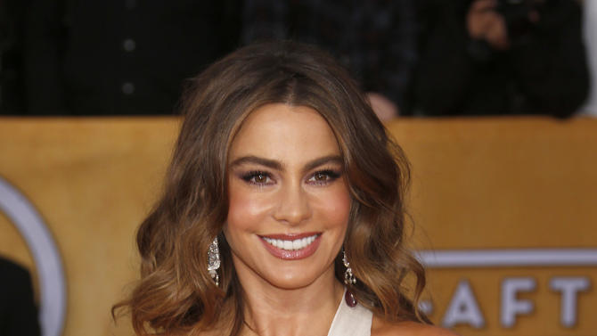 Sofia Vergara arrives at the 19th Annual Screen Actors Guild Awards at the Shrine Auditorium in Los Angeles on Sunday Jan. 27, 2013. (Photo by Todd Williamson/Invision for The Hollywood Reporter/AP Images)