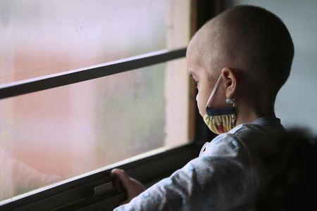 Sequera looks out the window while receiving chemotherapy treatment at a paediatric hospital in Maracaibo