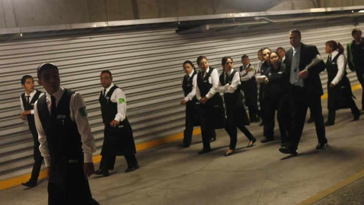 Waiters are evacuated from Mexico City Arena after a transformer exploded in Mexico City