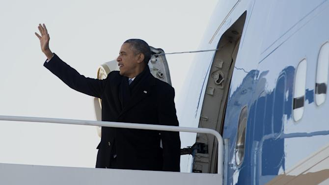 President Barack Obama waves as he boards Air Force One, Thursday, Jan. 30, 2014, at Andrews Air Force Base, Md., en route to Waukesha, Wis., to speak about job training. This trip to Waukesha, Wis., is part of a four-stop tour President Barack Obama is making to expand on themes from his State of the Union address. (AP Photo)