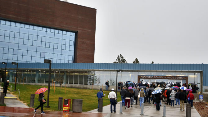 People wait to enter the Arapahoe County Justice Center on the first day of the trial of Aurora movie theater shootings defendant James Holmes, in Centennial, Colo., Monday, April 27, 2015. As the trial begins, the key won't be whether he caused the carnage, but whether Holmes was sane at the time of the killings. (AP Photo/Brennan Linsley)