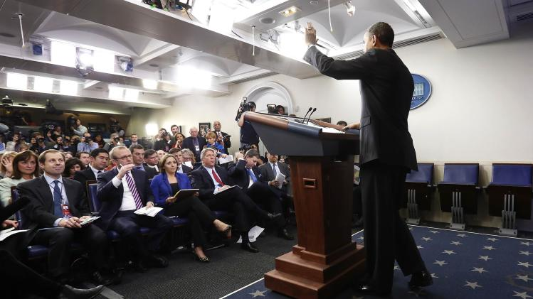 U.S. President Obama waves goodbye as he completes his year-end news conference in the White House Briefing Room in Washington