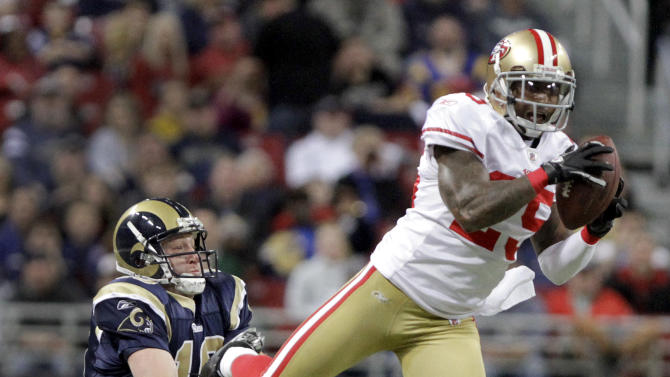 San Francisco 49ers cornerback Tarell Brown, right, intercepts a pass intended for St. Louis Rams' Kellen Clemens, left, during the second quarter of an NFL football game Sunday, Jan. 1, 2012, in St. Louis. (AP Photo/Seth Perlman)