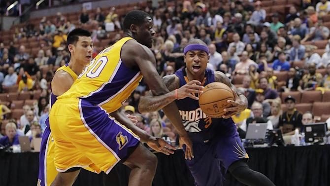 Phoenix Suns' Isaiah Thomas, right, is pressured by Los Angeles Lakers' Julius Randle, center, and Jeremy Lin during the second half of a preseason NBA basketball game Tuesday, Oct. 21, 2014, in Anaheim, Calif. The Suns won 114-108 in overtime. (AP Photo/Jae C. Hong)