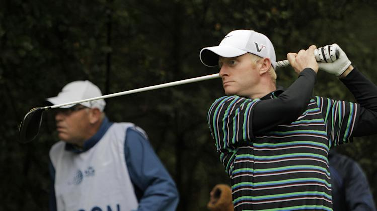 Simon Dyson of Britain, right, and his caddy Guy Tilston, left, watch the trajectory of the ball as Dyson tees off on 7th hole  at the KLM Open Golf tournament  in Hilversum, Netherlands, Thursday Sept. 8, 2011. (AP Photo/Peter Dejong)