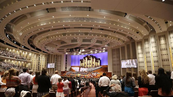 People gather inside the Conference Center during the 183rd Annual General Conference of The Church of Jesus Christ of Latter-day Saints Saturday, April 6, 2013, in Salt Lake City. The Mormon church is planning to build two new temples in Rio de Janeiro and Cedar City, Utah. The faith's president, Thomas S. Monson, announced the new temples on Saturday during the 183rd semi-annual general conference of The Church of Jesus Christ of Latter-day Saints. More than 100,000 members of the church have gathered in Salt Lake City to hear words of inspiration and guidance for daily living from the faith's senior leaders.  (AP Photo/Rick Bowmer)