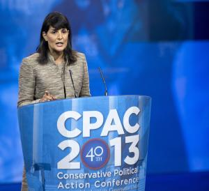 "FILE – In this March 15, 2013 file photo Republican governor of South Carolina Nikki Haley speaks at the 40th annual Conservative Political Action Conference (CPAC) in National Harbor, Md. As more Republicans give in to President Barack Obama's health-care overhaul, an opposition bloc remains across the South, which includes governors who lead some of the nation's poorest and unhealthiest states. ""We will not expand Medicaid on President Obama's watch. We will not expand Medicaid ever,"" Haley told the audience at CPAC. Medicaid is financed mostly by Congress, with state's putting up match funding. Obama's law mandated that states open Medicaid to everyone with household income up to 133 percent of the federal poverty rate, but the Supreme Court ruled states must have a choice.  (AP Photo/Manuel Balce Ceneta, File)"