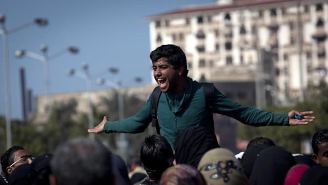 FILE - In this Thursday, Feb. 21, 2013 file photo, an Egyptian Ultras activist chants anti-President Mohammed Morsi slogans while leading a rally during the fifth day of a general strike, in Port Said, Egypt. Egypt's streets have turned into a daily forum for airing a range of social discontents from labor conditions to fuel shortages and the casualties of myriad clashes over the past two years. Newly called parliamentary elections hold out little hope for plucking the country out of the turmoil and if anything, are likely to just fuel unrest and push it toward economic collapse. (AP Photo/Nasser Nasser, File)