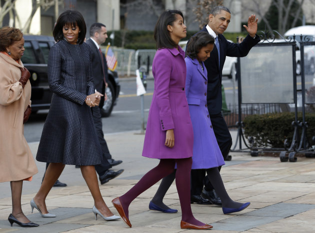 President Barack Obama, waves as he walks with his daughters Sasha and Malia, first lady Michelle Obama and mother-in-law Marian Robinson, to St. John&#39;s Church in Washington, Monday, Jan. 21, 2013, for a church service during the 57th Presidential Inauguration. (AP Photo/Jacquelyn Martin)