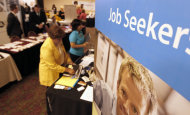 <p>               In this Tuesday, July 10, 2012 photo, people walk by the recruiters at a jobs fair in the Pittsburgh suburb of Green Tree, Pa. The number of people seeking unemployment benefits plunged last week to the lowest level in four years, a hopeful sign for the struggling job market. But the decline was partly due to temporary factors. (AP Photo/Keith Srakocic)
