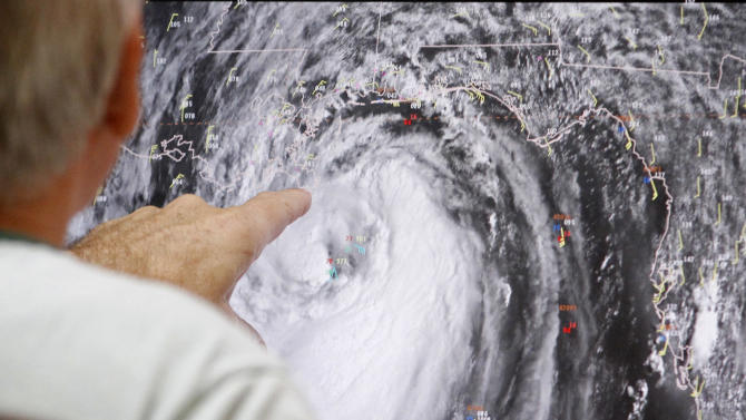 Senior hurricane specialist Stacy Stewart tracks Isaac at the National Hurricane Center in Miami, Tuesday, Aug. 28, 2012. Forecasters at the National Hurricane Center warned that Isaac, especially if it strikes at high tide, could cause storm surges of up to 12 feet (3.6 meters) along the coasts of southeast Louisiana and Mississippi and up to 6 feet (1.8 meters) as far away as the Florida Panhandle. (AP Photo/Alan Diaz)