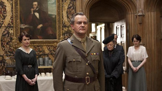 """In this image released by PBS, from left, Elizabeth McGovern as Lady Cora, Hugh Bonneville as Lord Grantham, Maggie Smith as the Dowager Countess and Michelle Dockery as Lady Mary are shown in a scene from the second season of """"Downton Abbey."""" PBS' drama series """"Masterpiece,"""" which includes the hit """"Downton Abbey,"""" has received a $1 million gift from a philanthropist in California. (AP Photo/PBS, Carnival Film & Television Limited 2011 for MASTERPIECE, Nick Briggs)"""