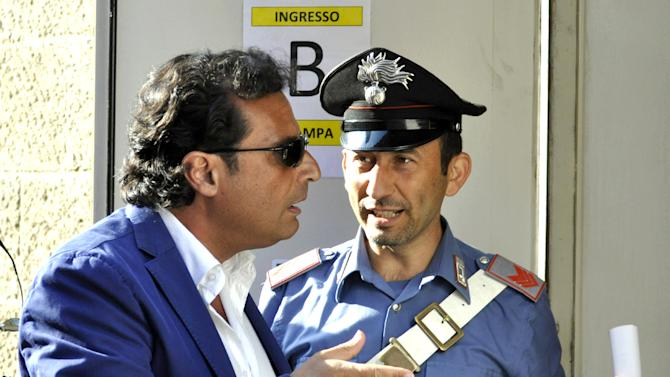 Captian Francesco Schettino arrives for his trial, in Grosseto, Italy, Tuesday, July 9, 2013. The trial of the captain of the shipwrecked Costa Concordia cruise liner has begun in a theater converted into a courtroom in Tuscany to accommodate all the survivors and relatives of the 32 victims who want to see justice carried out in the 2012 tragedy. The sole defendant, Schettino, made no comment to reporters as he arrived for his trial on charges of multiple manslaughter, abandoning ship and causing the shipwreck near the island of Giglio. His lawyer, Domenico Pepe, told reporters that, as expected, the judge was postponing the hearing though due to an eight-day nationwide lawyers' strike. Schettino has denied wrongdoing. (AP Photo/Giacomo Aprili)