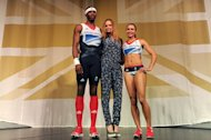 British athletes triple jumper Phillips Idowu (L) and heptathlete Jessica Ennis (R) pose with designer Stella McCartney (C)in the Olympic Team GB kit she designed