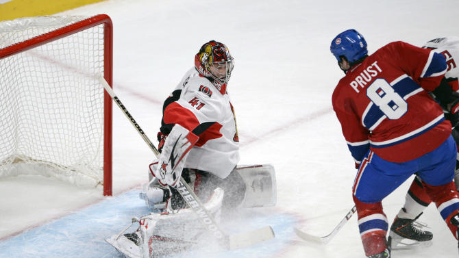 Ottawa Senators goaltender Craig Anderson stops Montreal Canadiens right wing Brandon Prust (8) during the first period of NHL hockey Game 2 first-round playoff action in Montreal, Friday, May 3, 2013. (AP Photo/The Canadian Press, Ryan Remiorz)