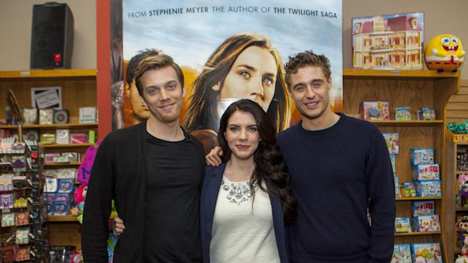 """Actor Jake Abel, writer Stephenie Meyer and actor Max Irons during """"The Host"""" book signing at the Anderson's Bookshop on Monday, March 11, 2013, in Chicago. (Photo by Barry Brecheisen/Invision/AP)"""