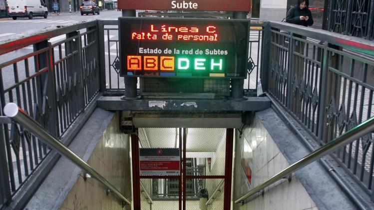 "An electronic board reads ""Closed due to lack of personnel"" at the entrance of a subway during a 24-hour strike across Argentina in Buenos Aires"