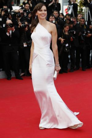 Actress Hilary Swank poses as she arrives for the screening of The Homesman at the 67th international film festival, Cannes, southern France, Sunday, May 18, 2014. (AP Photo/Alastair Grant)