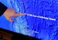 Asis Perez, Director of the Philippine Bureau of Fisheries and Aquatic Resources, points to a map on May 10, 2013 to show where the Philippine coastguard shot at a Taiwanese fishing vessel near Balintang island. Philippine coastguard spokesman Commander Armand Balilo said the incident took place in Philippine waters