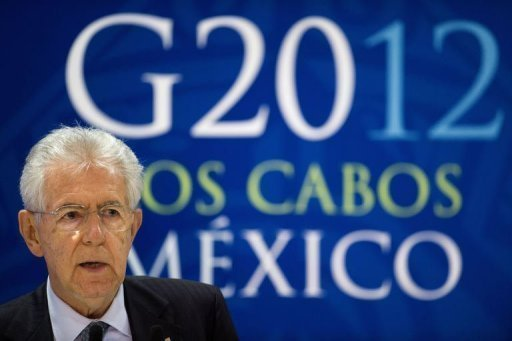 <p>Italian Prime Minister Mario Monti delivers a speech at the end of the G20 Summit of Heads of State and Government in Los Cabos, Baja California, Mexico, on June 19. Eurozone leaders faced mounting pressure from impatient G20 partners on Wednesday to accelerate integration, while Spain fought to avoid needing a full debt rescue.</p>