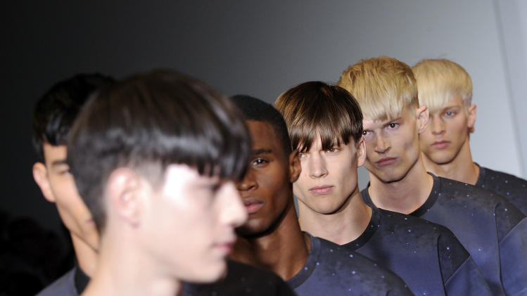 Models on parade at the end of Calvin Klein men's Spring-Summer 2014 collection, part of the Milan Fashion Week, unveiled in Milan, Italy, Sunday, June 23, 2013. (AP Photo/Giuseppe Aresu)