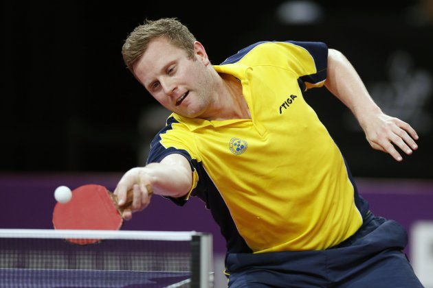 Jens Lundqvist of Sweden plays in his men's singles third round match at the World Team Table Tennis Championships in Paris