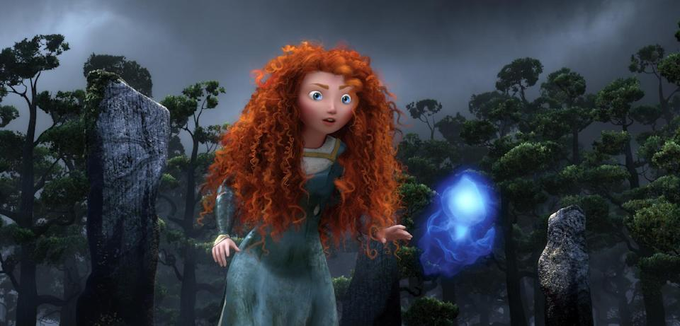 "FILE - In this undated file film image released by Disney/Pixar, the character Merida, voiced by Kelly Macdonald, follows a Wisp in a scene from ""Brave."" (AP Photo/Disney/Pixar)"