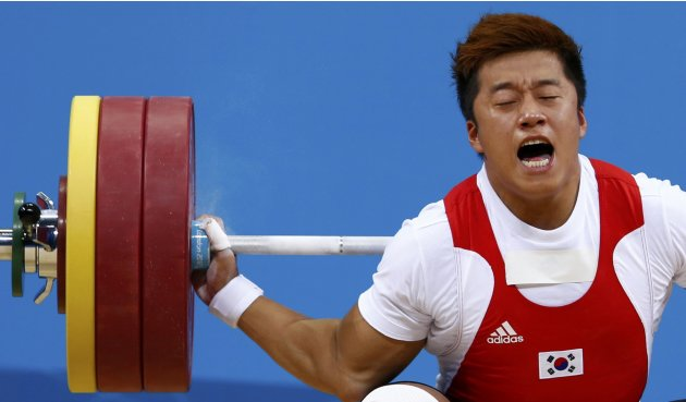 South Korea's Jaehyouk Sa injures his arm on the men's 77Kg Group A weightlifting competition at the ExCel venue at the  London 2012 Olympic Games