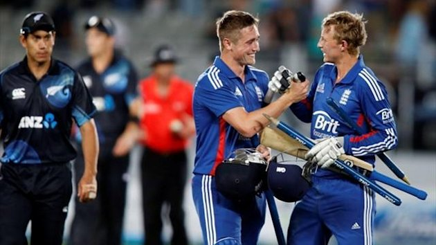 England&#39;s Joe Root and Chris Woakes celebrate victory over New Zealand (Reuters)
