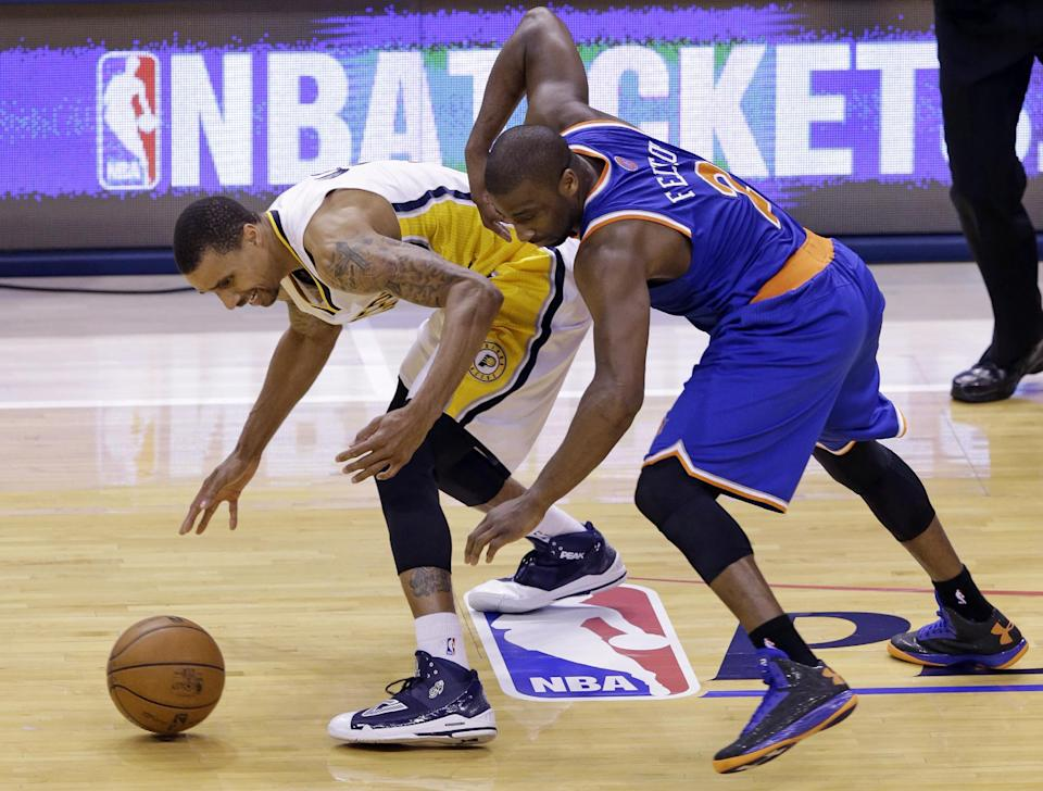 Indiana Pacers guard George Hill, left, steals the ball from New York Knicks guard Raymond Felton during the second quarter of Game 6 of the Eastern Conference semifinal NBA basketball playoff series in Indianapolis, Saturday, May 18, 2013. (AP Photo/Michael Conroy)